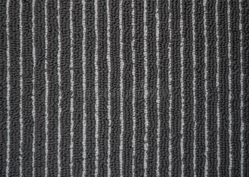 Tapissez la texture dans le bureau, plein concept de cadre Fermez-vous du fond ou du modèle gris monochrome de tapis d'en haut Vu photos libres de droits
