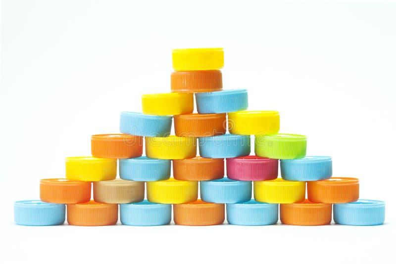 Tapones de tuerca plásticos coloridos de la botella imágenes de archivo libres de regalías