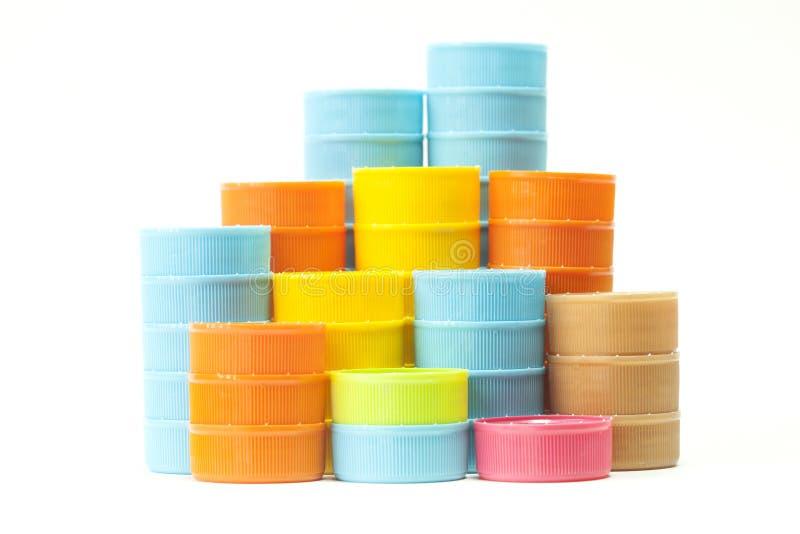 Tapones de tuerca plásticos coloridos de la botella fotos de archivo libres de regalías
