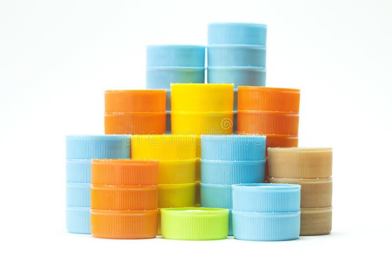 Tapones de tuerca plásticos coloridos de la botella fotografía de archivo