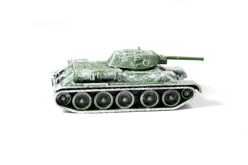 Tappning anv?nde barnets Toy Tank On White Background arkivfoton