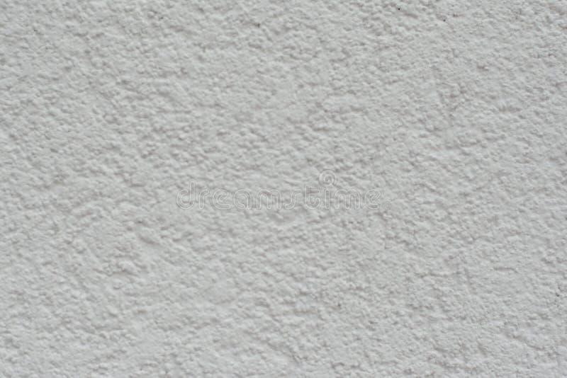 Tappning eller grungy vit bakgrund av naturlig gammal textur för cement eller för sten som en retro modellvägg Det är ett begrepp fotografering för bildbyråer