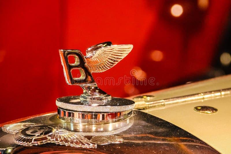 tappning för sepia för bilbil retro Bentley emblem royaltyfri fotografi