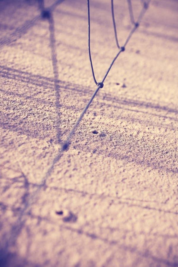 Tappning filtrerat foto av hål i sand royaltyfri fotografi