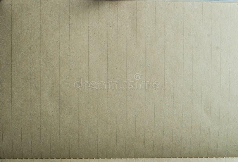 Tappning fodrad pappers- eller anteckningsbokpapperstextur arkivbilder