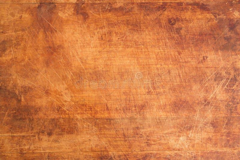 Tappning skrapad träskärbräda arkivbild