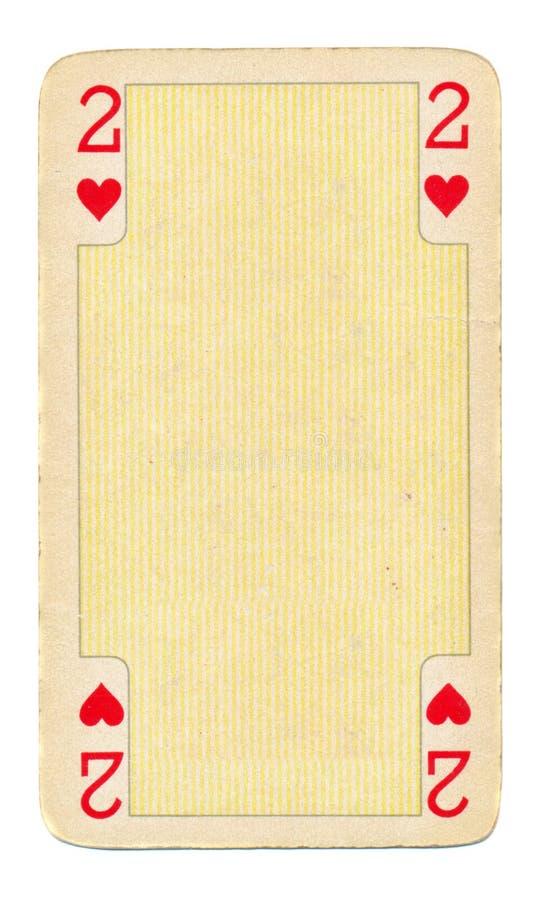 Tappning som spelar kortet med hjärtabakgrund royaltyfri fotografi