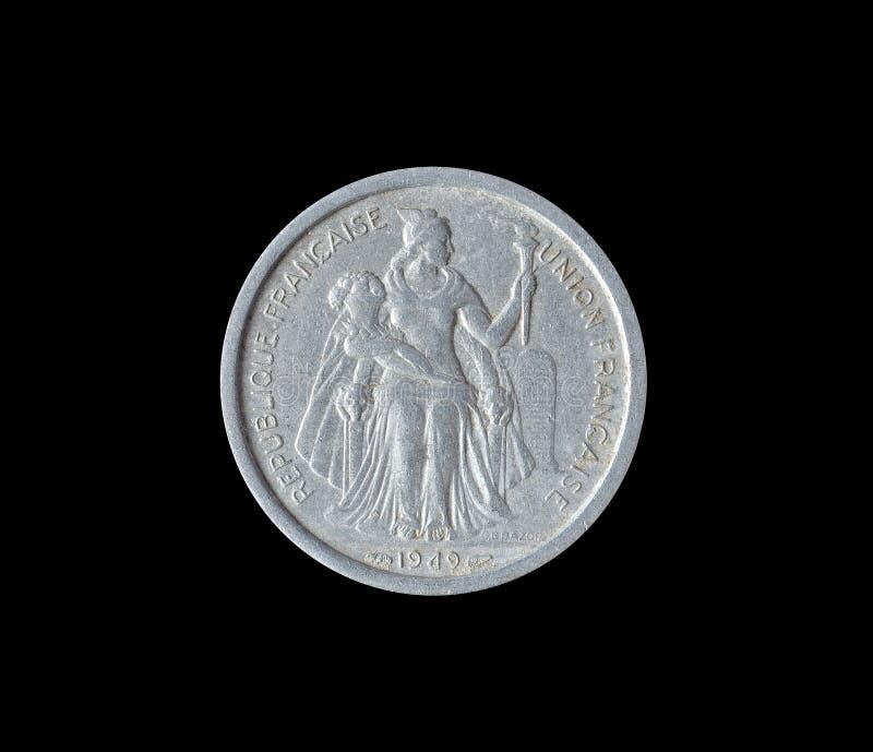 Tappning två franc mynt som göras av franska Oceanien 1949 royaltyfria bilder