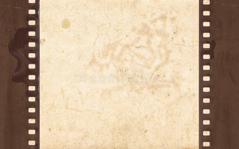 Tappningbakgrund med retro papper och den gamla filmremsan royaltyfri foto