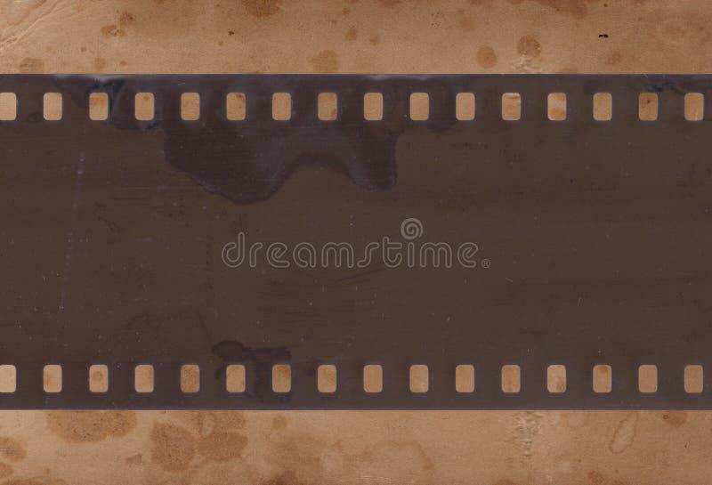 Tappningbakgrund med retro papper och den gamla filmremsan arkivbilder