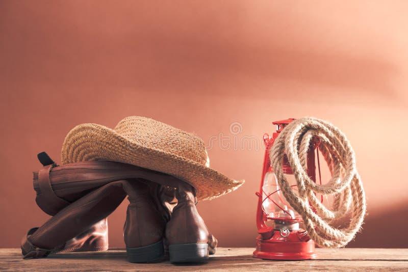 Tappningcowboyhjälpmedel arkivbild