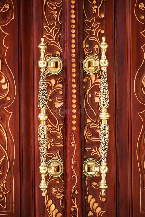 Tappningdörrhandtag royaltyfria foton