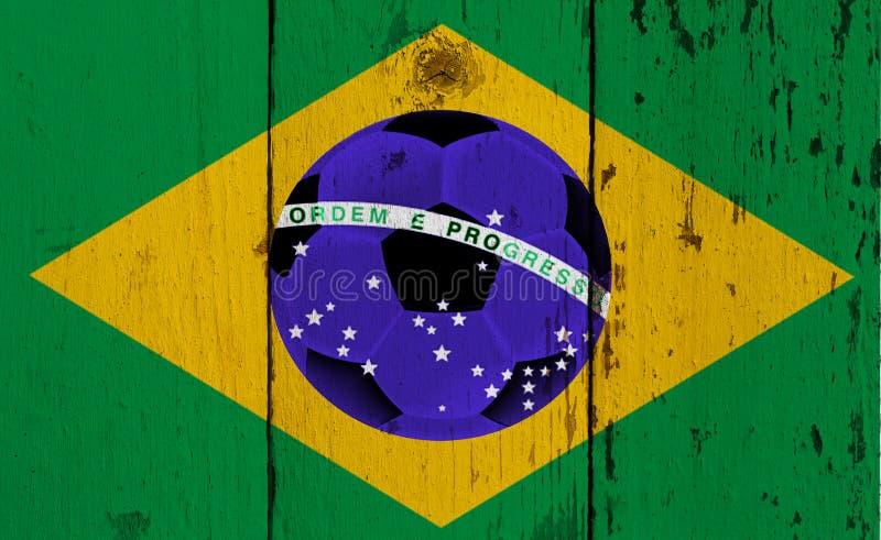 Tappningfoto av den Brasilien flaggan och fotbollbollen royaltyfri fotografi