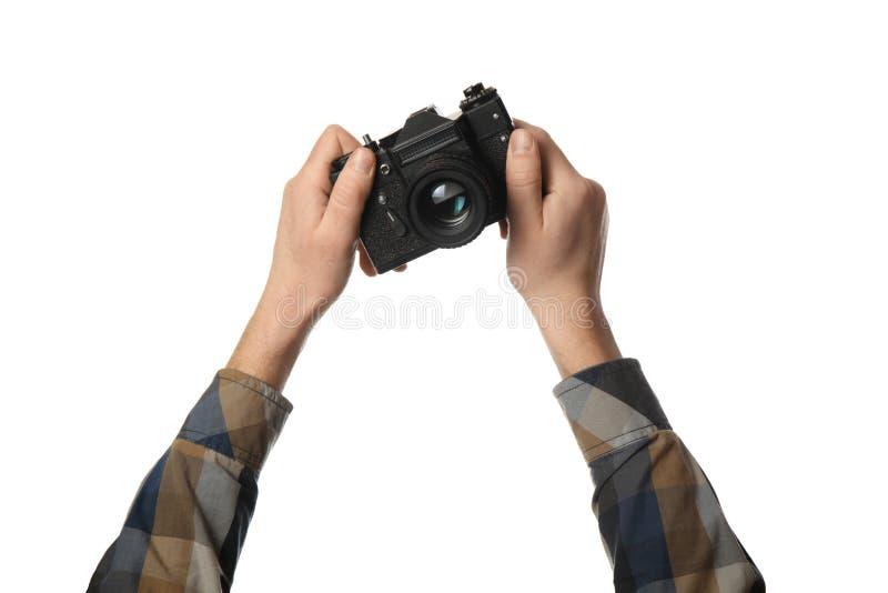 Tappningkamera i handen som isoleras p? vit bakgrund Fotografi och minnen arkivbild