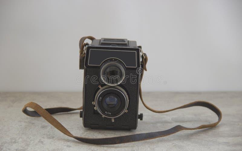 Tappningkamera med remmen arkivfoto