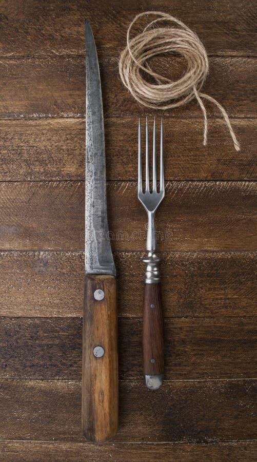Tappningkniv och gaffel arkivbild