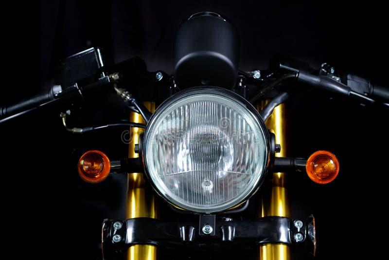 Tappningmotorcykelbillyktor royaltyfri bild