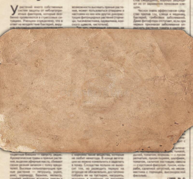 Tappningpapper på den gamla tidningstexturen arkivfoto