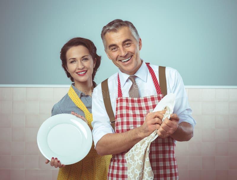 Tappningparmaträtt som tillsammans tvättar sig arkivbilder