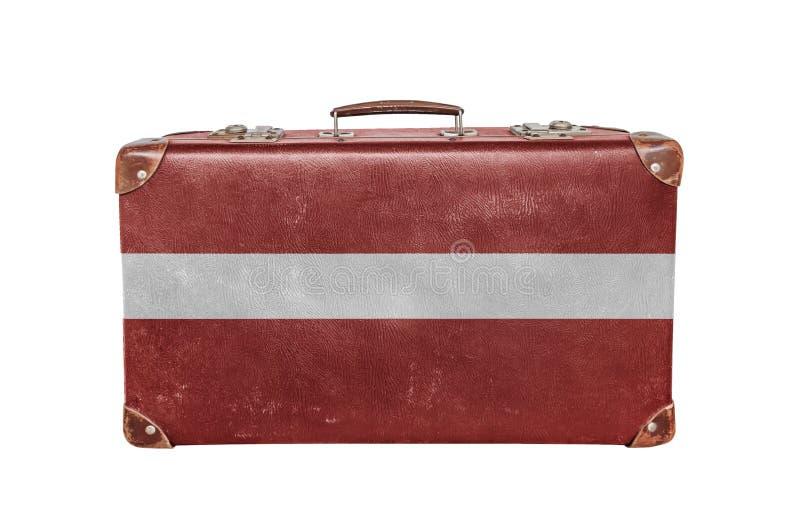 Tappningresväska med den Lettland flaggan arkivfoto