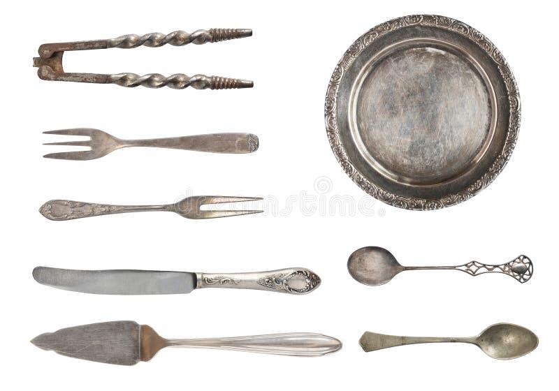 Tappningskedar, gafflar och platta som isoleras på vit bakgrund antik silverware royaltyfria bilder