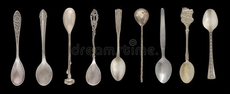 9 tappningteskedar som isoleras på en svart bakgrund Lantlig stil silverware royaltyfria bilder