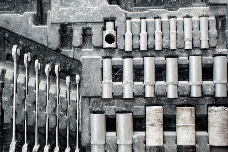 Tappninguppsättning av justerbara metalliska tangenter för bilindustri arkivfoto