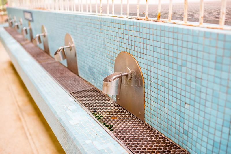 Taps of the pump-room. Of the old Vichy spa in France royalty free stock photos