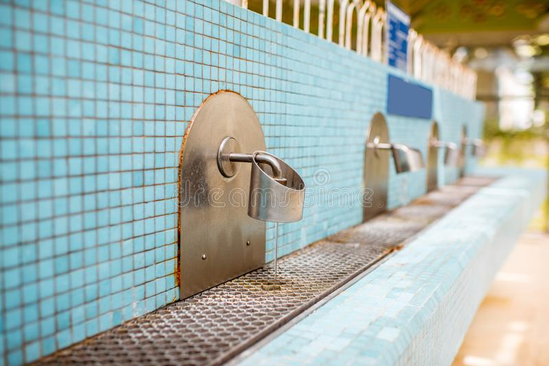 Taps of the pump-room. Of the old Vichy spa in France stock images