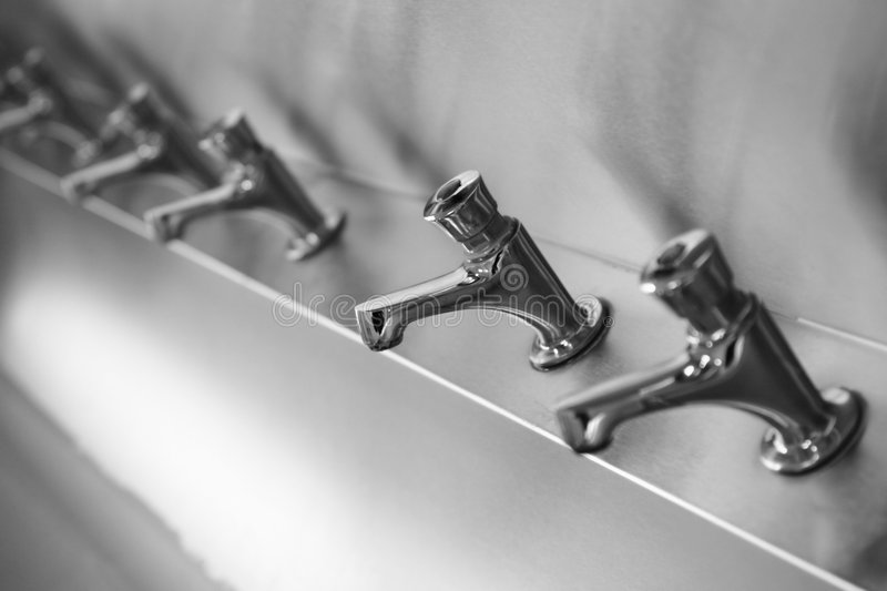Taps In A Row Stock Photo