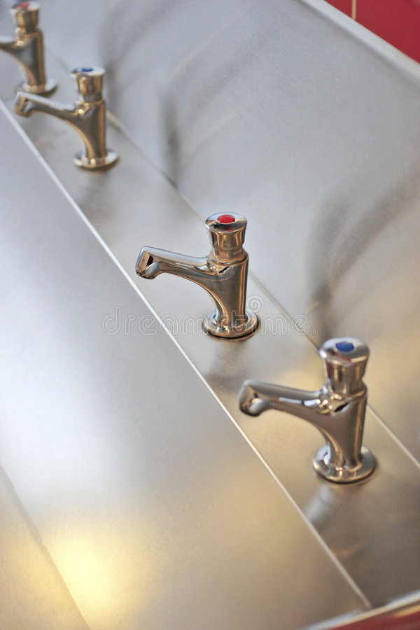 Download Taps in a row stock photo. Image of stainless, faucet - 1591924