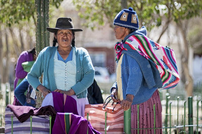 Unidentified indigenous native Quechua people in traditional clothing at the local Tarabuco Sunday Market, Bolivia. TARABUCO, BOLIVIA - AUGUST 06, 2017 royalty free stock images