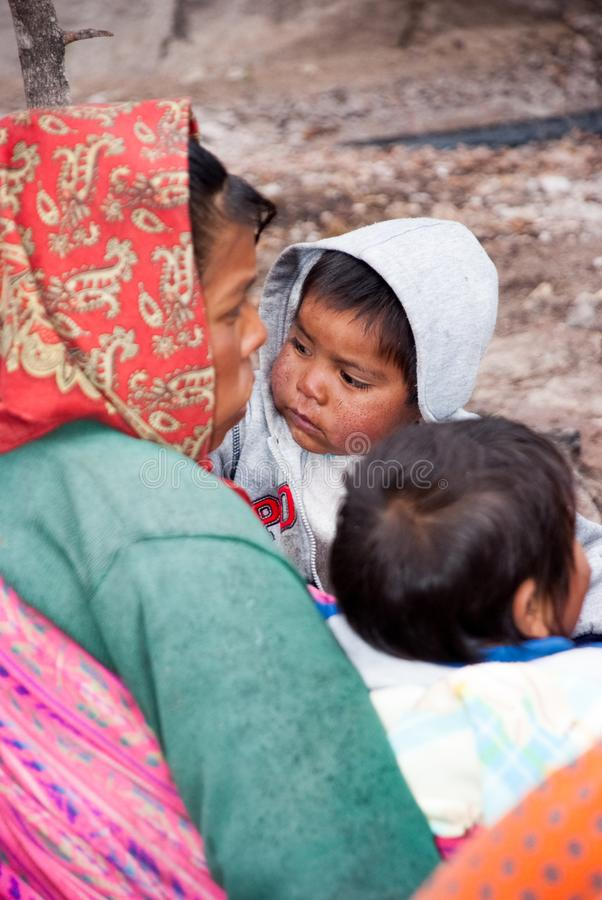 Tarahumara Indian family - mother and kid in Copper Canyon. March 03, 2010 - Copper Canyon - Sierra Madre, Chihuahua State, Mexico, South America royalty free stock image