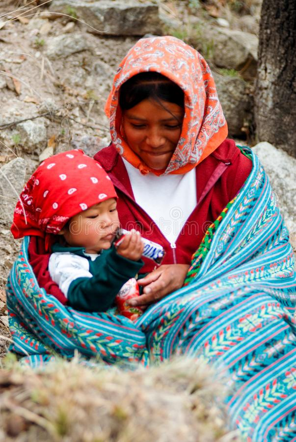 Tarahumara Indian family - mother and kid in Copper Canyon. March 03, 2010 - Copper Canyon - Sierra Madre, Chihuahua State, Mexico, South America stock photography