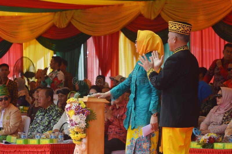 March of archipelago culture - APEKSI 2018 in Tarakan City. TARAKAN - INDONESIA, 25th July 2018 :mayor of South Tangerang, Airin with the mayor of Tarakan royalty free stock image