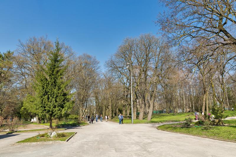 Taras Shevchenko park in Rovno, Ukraine. ROVNO, UKRAINE - APRIL 09, 2018: Unrecognized people walk in the Taras Shevchenko early spring park. Rovno or Rivne is a royalty free stock photography