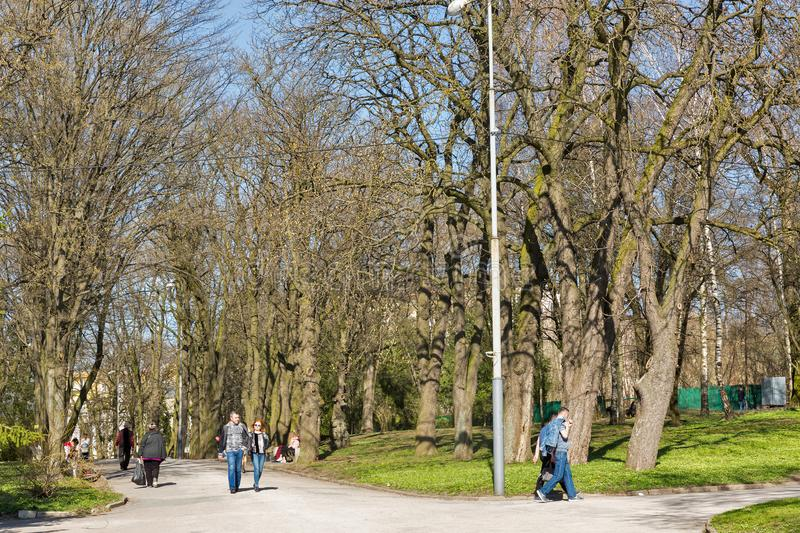 Taras Shevchenko park in Rovno, Ukraine. ROVNO, UKRAINE - APRIL 09, 2018: Unrecognized people walk in the Taras Shevchenko early spring park. Rovno or Rivne is a royalty free stock image