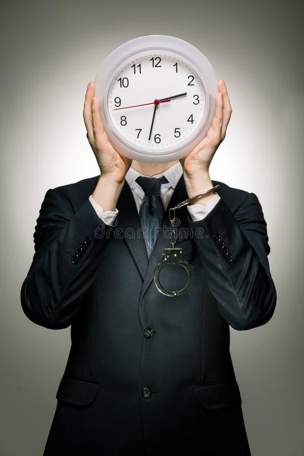 Tarde ocupada no trabalho e no tempo da passagem imagem de stock