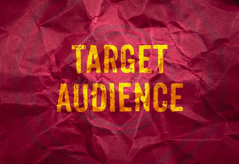 Target Audience in gold texture on crumpled red paper background royalty free stock images