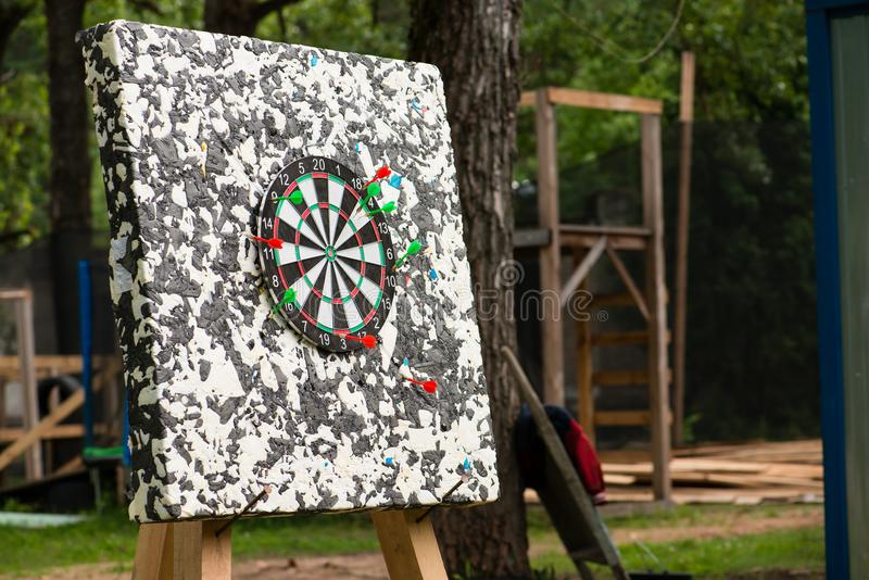 Target with darts outdoors royalty free stock images