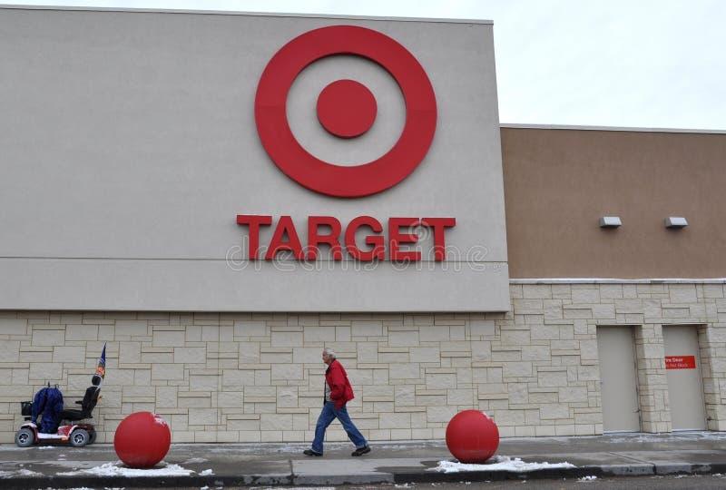 Target store signage. Man walks fast below the Target store signage in front of the building royalty free stock photo