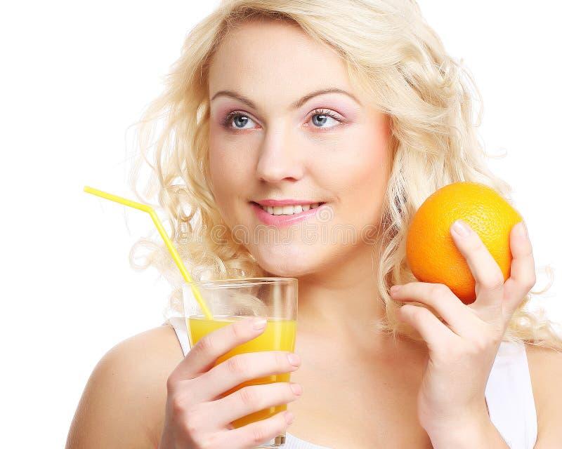 target2612_0_ szczęśliwa soku pomarańcze kobieta zdjęcia royalty free