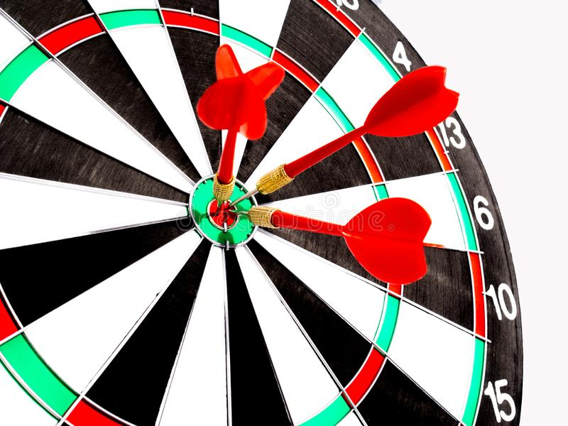 Target with three red dart focus on bull`s eye, Setting challenging business goals And ready to achieve the goal with teamwork royalty free stock image