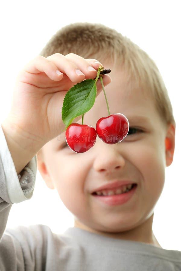 target1200_1_ dzieciaka chłopiec cheries młody zdjęcia royalty free