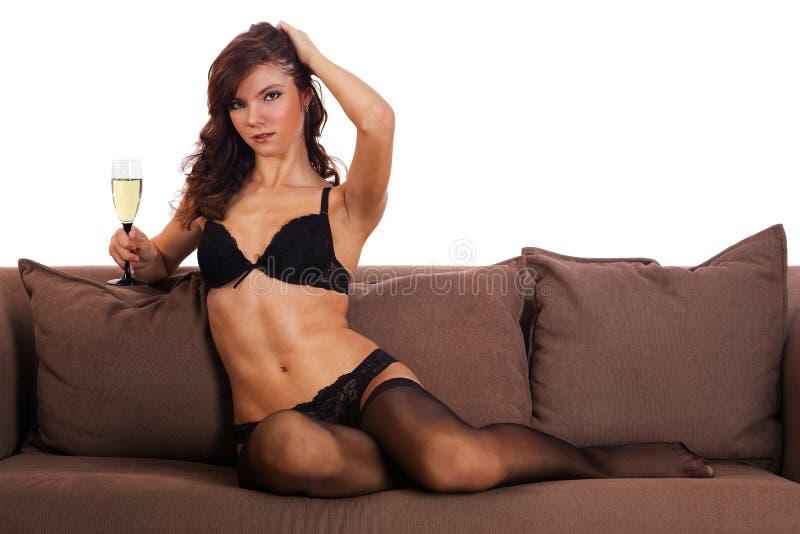 target1823_0_ kanapy bieliznę brunetki czarny dziewczyna fotografia stock