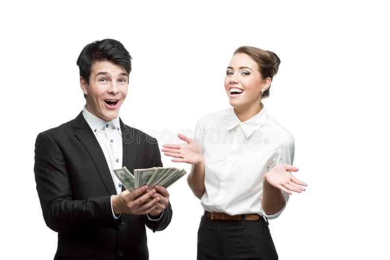 TARGET517_1_ pieniądze młodzi uśmiechnięci ludzie biznesu obraz royalty free