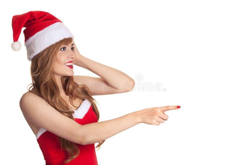 TARGET591_0_ Santa kapelusz boże narodzenie zdziwiona kobieta zdjęcie royalty free