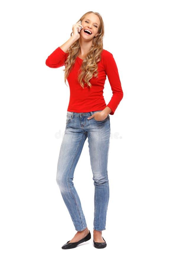 TARGET615_0_ na telefonie uśmiechnięta młoda blond kobieta obrazy stock