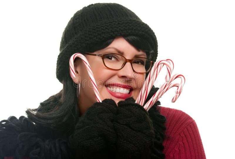 target838_1_ ładnej kobiety cukierek trzciny zdjęcie stock