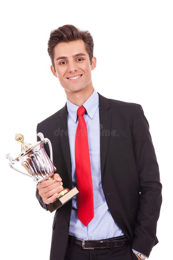 TARGET913_1_ filiżanki trofeum mężczyzna biznesowy zwycięzca fotografia royalty free